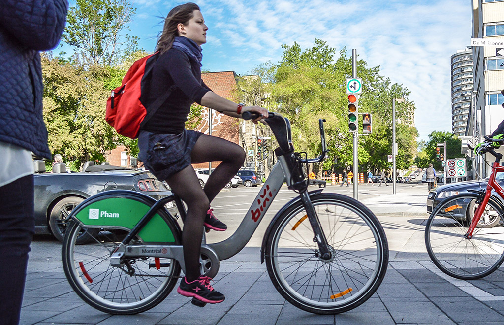 One of Montreal's ubiquitous BIXI users on the Maisonneuve cycle track downtown. Photo by Chris Bruntlett