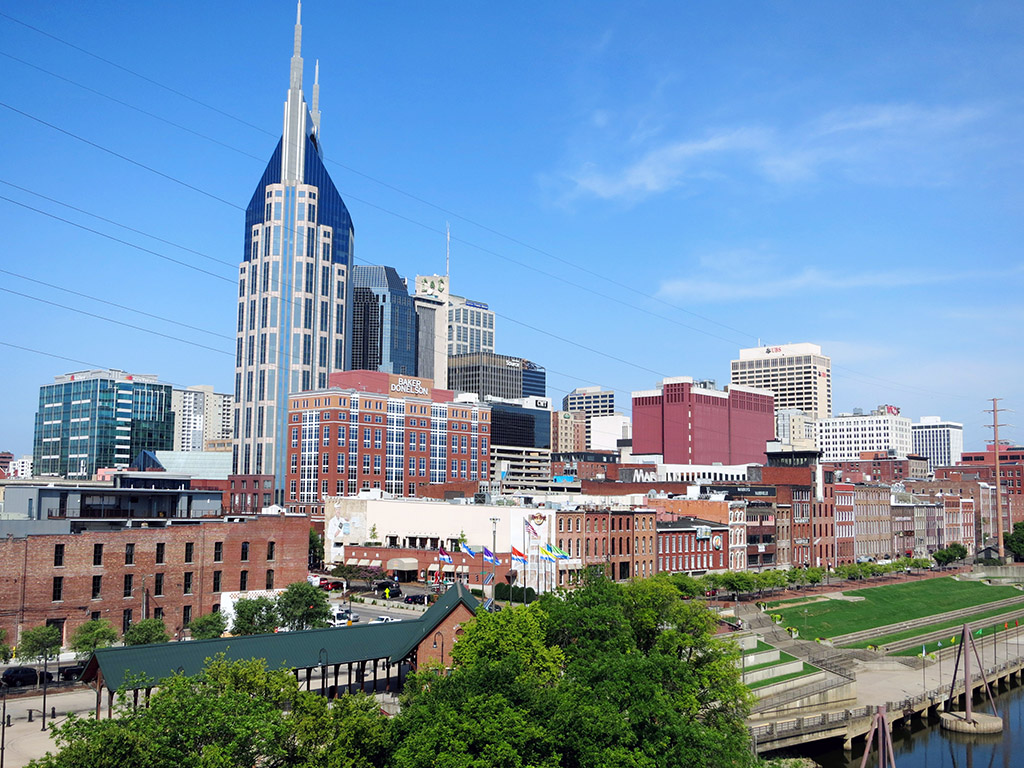 The Nashville skyline as seen from the pedestrian bridge crossing the Cumberland River. The green space near the river often features live music and is one of the best places to watch the Fourth of July fireworks display, the largest in the South. Photo by Trisha Ping