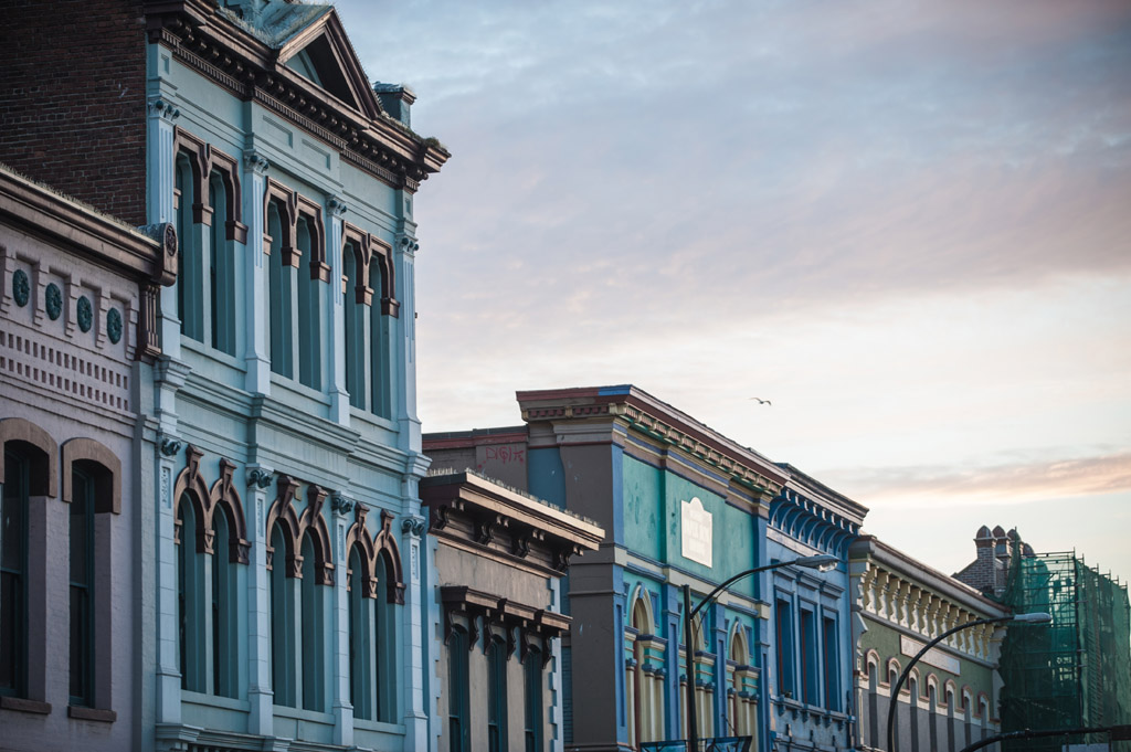 Originally built in the 1890s, many of the original buildings along Lower Johnson Street still stand and have been painted brightly. The area is known for its trendy, upscale boutiques and shops.