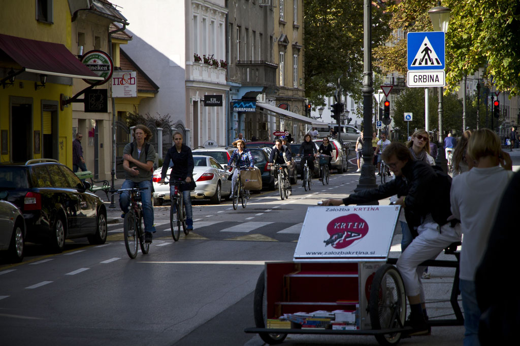 Afternoon traffic on the left, the Library Bike in Ljubljana on the right.