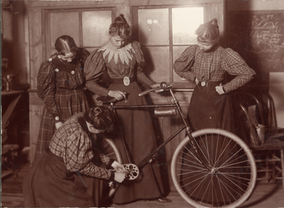 """Women repairing bicycle."" Unknown photographer, from ""Women Repairing Bicycle, c. 1895"" by Unknown - http://arc.lib.montana.edu/msu-photos/item/135. Licensed under CC BY-SA 3.0 via Wikimedia Commons."