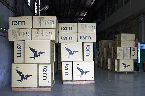 Small footprint shipping boxes, seen here at Tern's Taiwan production facility, allow Tern to fit more onto a shopping container, saving shipping costs. Photo courtesy of Tern.