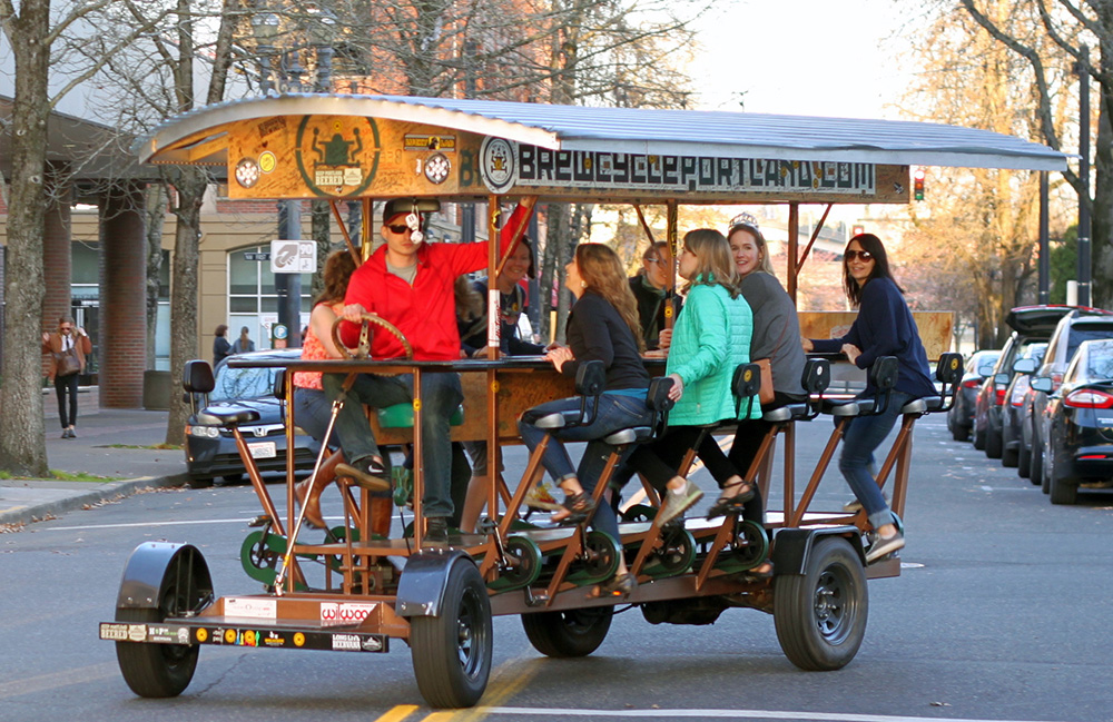 The BrewCycle rides through Old Town Portland