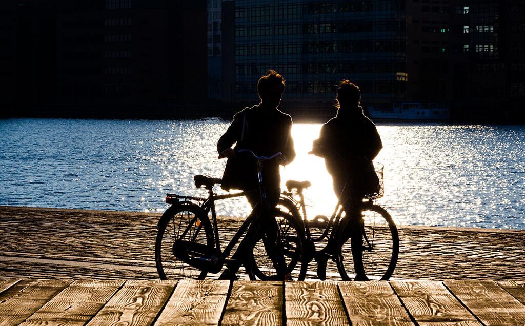 Date ideas - couple on bikes at sunset
