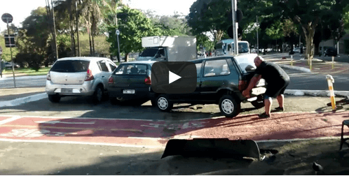 This Man Lifting a Car Is Every Frustrated Bike Rider's Hero