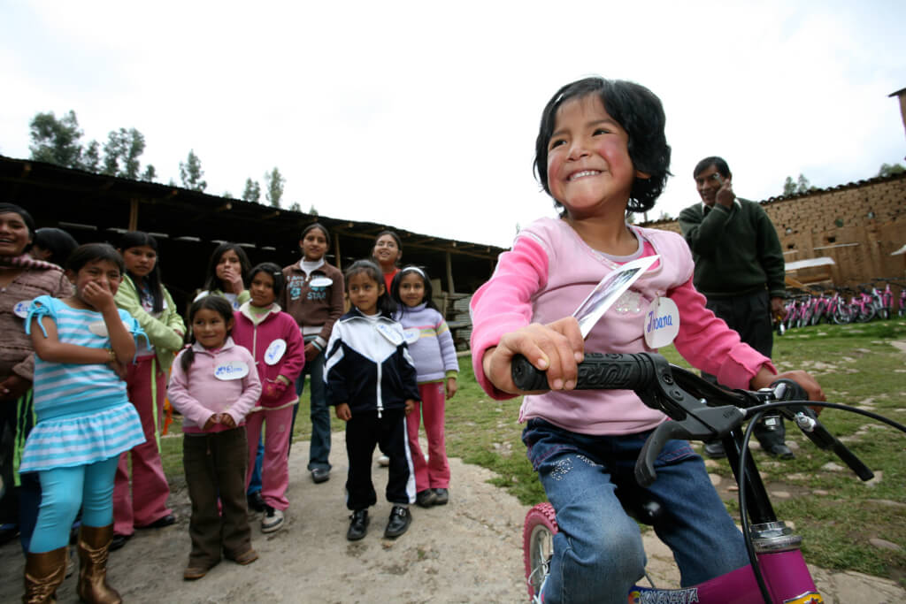 88Bikes Foundation, a young girl receives bike in Peru