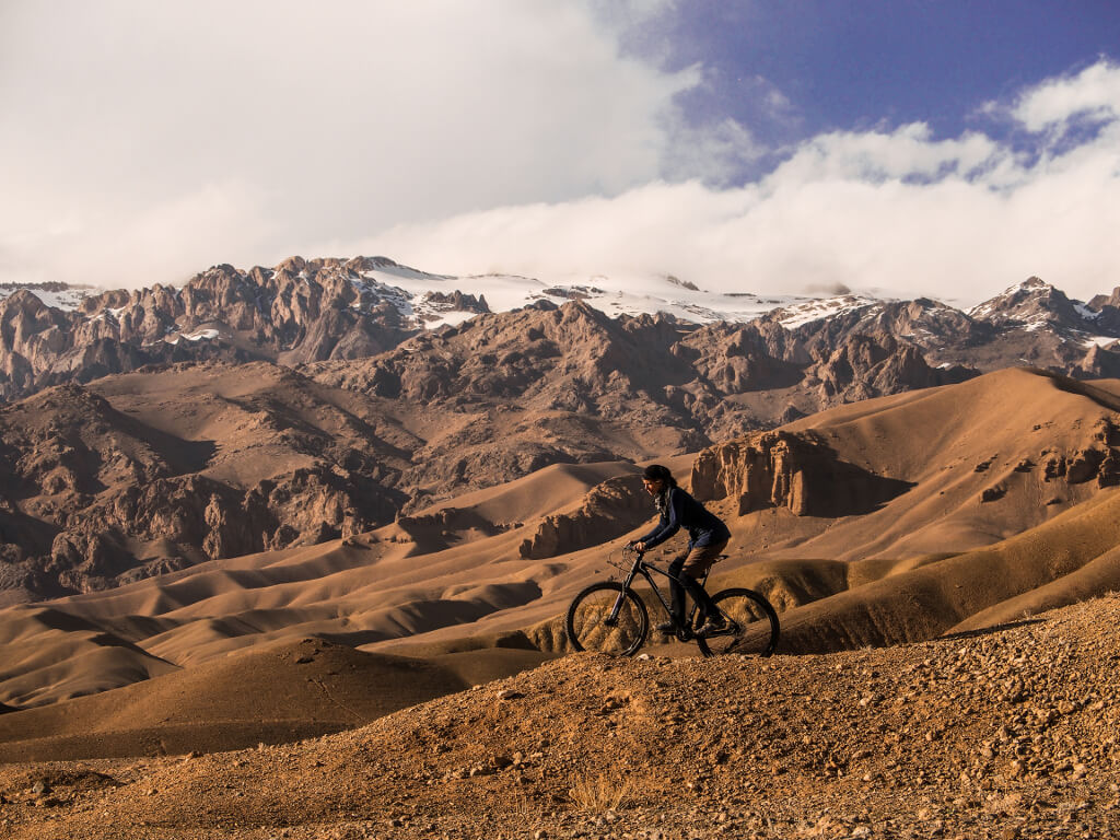 Riding on the plateau above the large Buddha niche in Bamiya, Afghanistan.