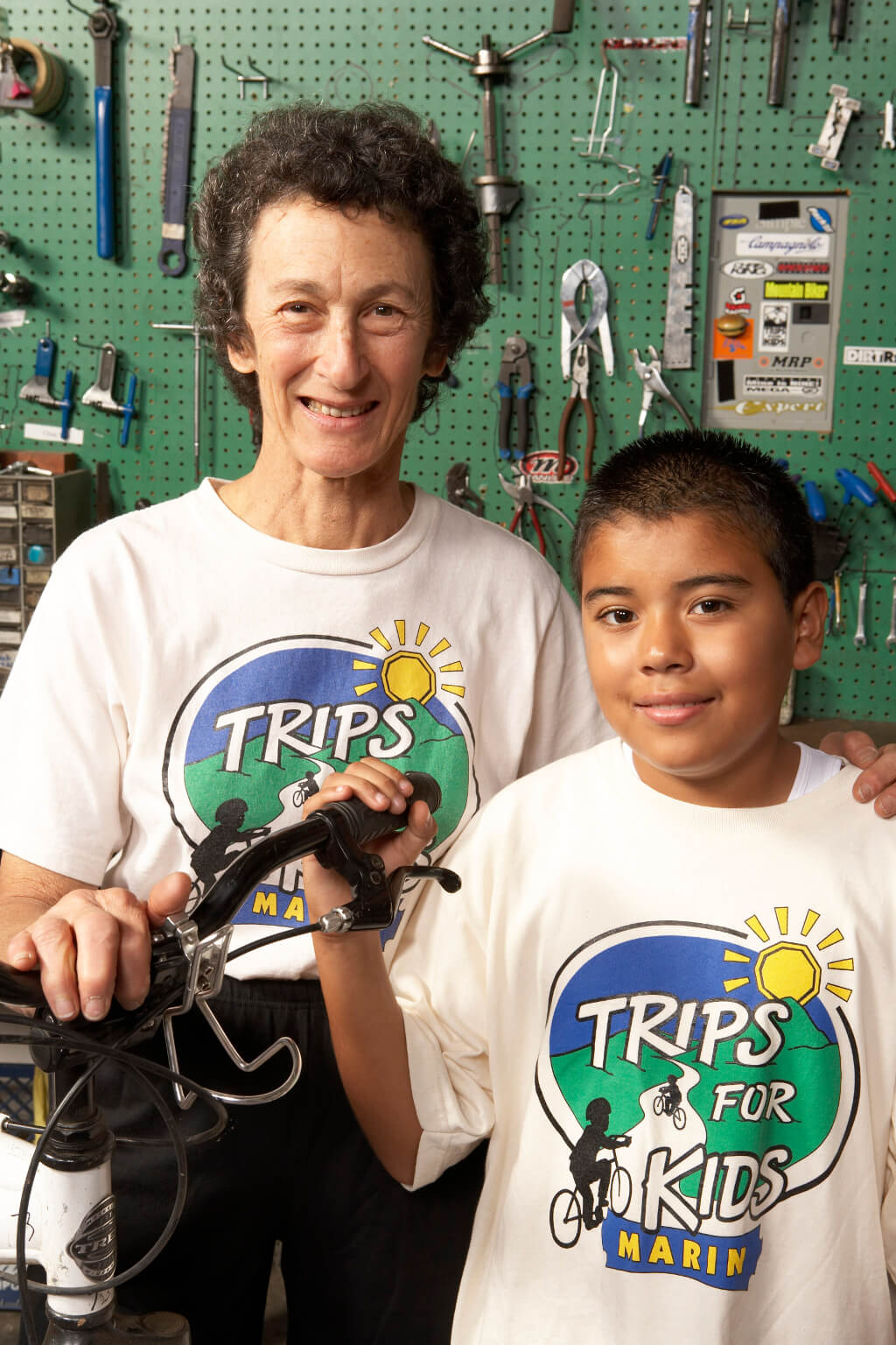 Marilyn Price and child after Trips For Kids after-school Earn-a-Bike program, circa 2006.
