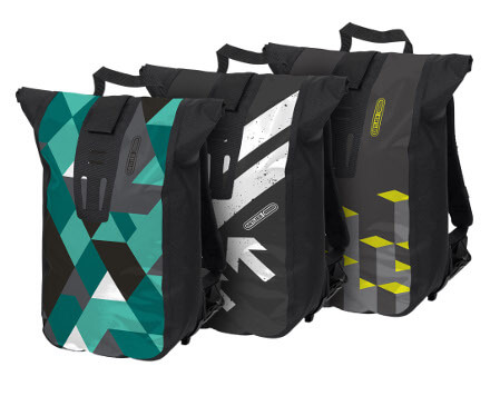 Ortlieb Velocity Design, three Bike bags in Turquoise, White, and Yellow
