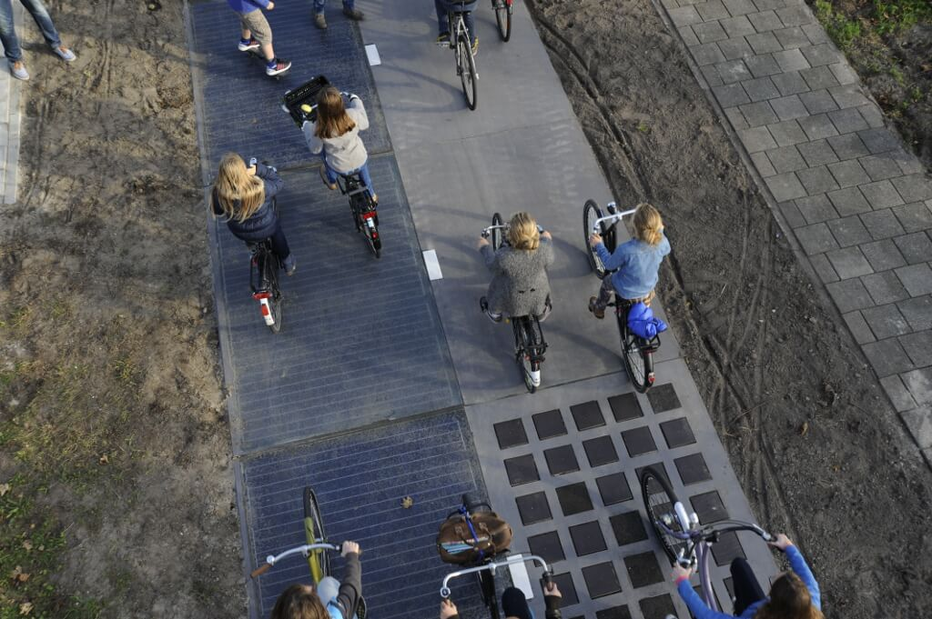 People using the prototype solar bike path by foot and bike.