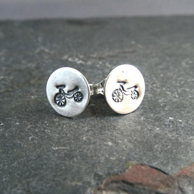 Silver stud earrings with Bicycling imprint