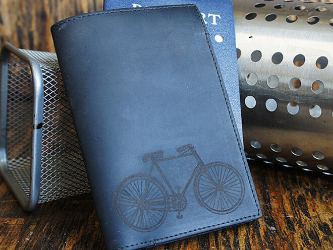 Blue passport with bicycle print