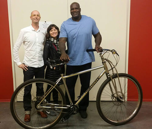 Shaq with his custom DirtySixer, with Folch and his wife.