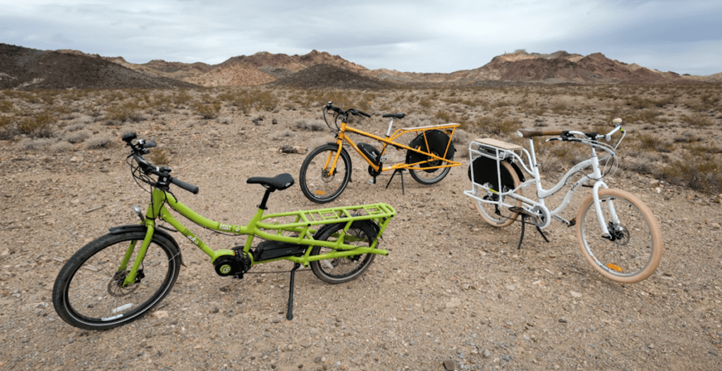 Three electric cargo bikes from Yuba. L-R: The Spicy Curry, the elMundo, and the elBoda Boda V3. Photo by David Niddrie