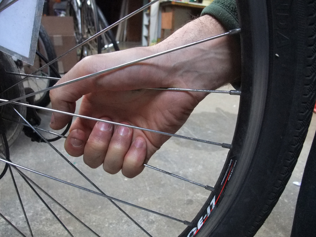 How to fix a bent motorcycle spoke rim