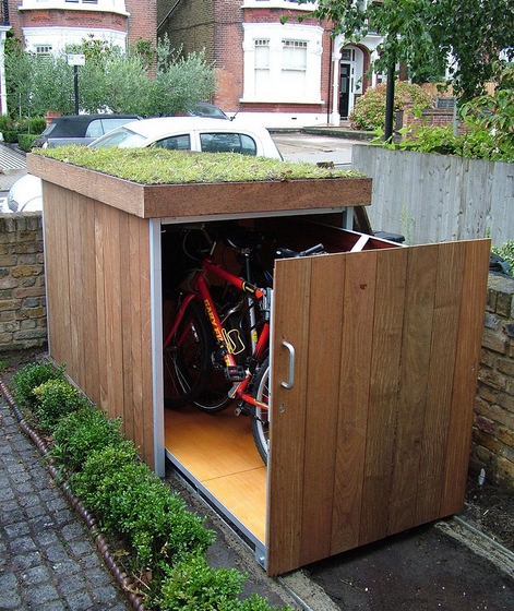 8 ways to store your bike that look cool momentum mag for Motorcycle storage shed